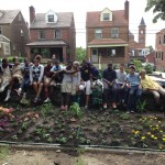 Arsenal Students Plant Flowers